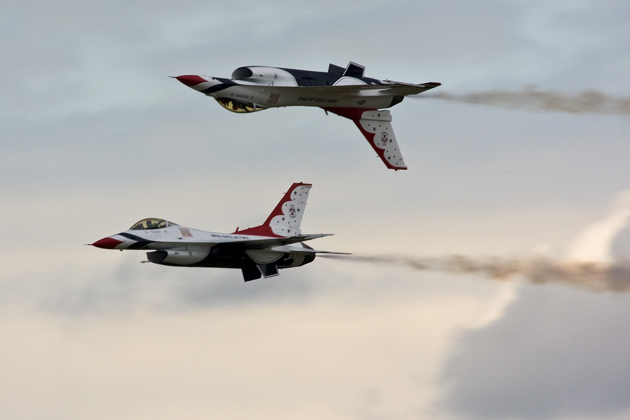 Thunderbird 5 and 6 fly a mirror formation.