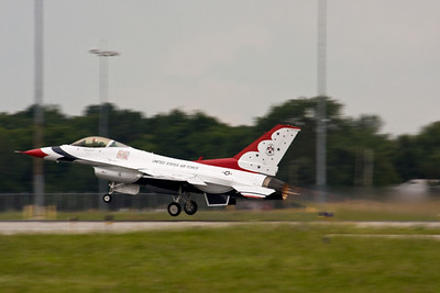 The Block 52 F-16C contains a Pratt and Whitney F100-PW-229 afterburning turbofan engine.  These provide up to 29,160 foot lbs of thrust with the afterburner in an aircraft that weighs nearly 19,000 lbs empty.  This gives it the ability to climb vertically if need be and reach mach 2+ in level flight.  The F-16 is a small aircraft by modern fighter standards at only 49.5 feet in length and 31 feet in wingspan.  The F-15, for example, is more than ten feet larger in both length and span.