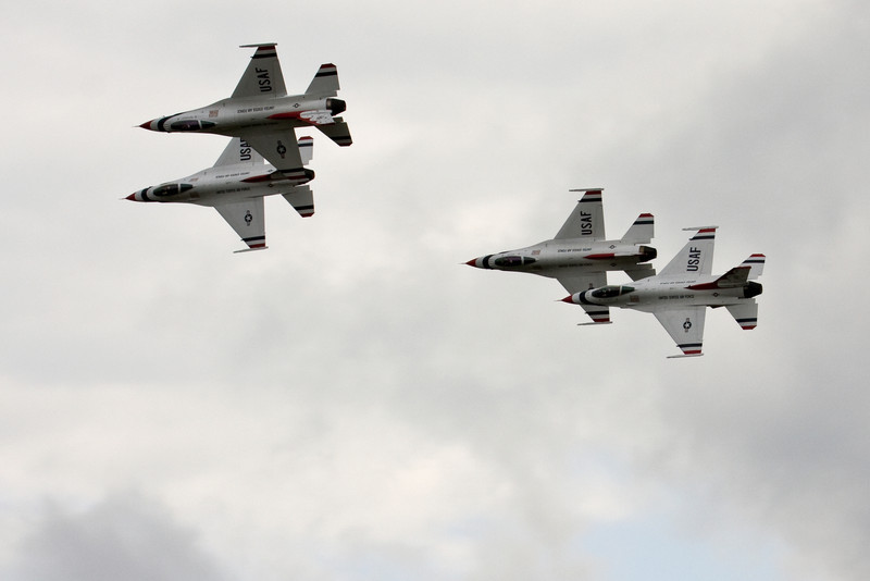 All four aircraft doing slow rolls as they pass the audience in diamond formation.