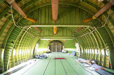 The interior has a strong structural bulkhead to support the Shuttle -- not part of passenger 747s.