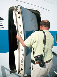 Paul Spana invites us into the airplane.