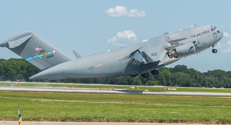 C-17 Globemaster III rotating off Runway 14 - 32