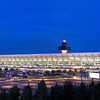 Washington Dulles International Airport Main Terminal after sundown, illuminated with pink lights to mark the beginning of the National Cherry Blossom Festival.<br /> <br /> Problems arose on for the interior accent lighting atop the ticket counters; the bright lights' heat melted and burned most of the pink color gels, so they had to be removed.  The exterior lights remain for another few days.