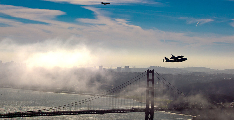 The space shuttle Endeavour flies over the Golden Bridge  in San Francisco, Calif., on Friday, September, 21st  2012.