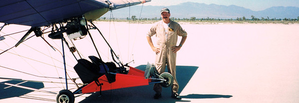 On the ground safe and unharmed. However the ultralight sustained heavy damage to the airframe, and the engine was blown.