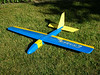 "This is my newly refurbished Eraser 48 built by California Sailplanes  <a href=""http://www.californiasailplanes.com/"">http://www.californiasailplanes.com/</a>). This was my first plane and has been the most enjoyable and versatile. After teaching myself and many others how to fly on it, this aircraft has been subjected to an estimated 60+ crashes... it finally had had enough and needed a make-over. My red, yellow, green, white, and black ""ugliest-plane-on-the-planet"" has become quite the looker. The next phase in the make-over is a balsa V-tail."