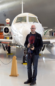 Andrew in front of his new private jet.