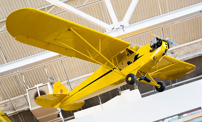 Piper Cub with an anachronistic engine mounted in it.
