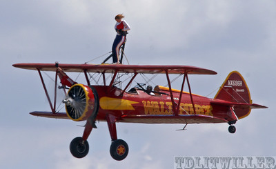 """Florida International Air show""  Walt Pierce's Stearman with 2 wing walkers"