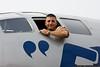 "Chris Baranaskas, pilot of P-51 ""Glamorous Gal"" checks out Fifi."