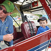 3-year-old Thomas Whitney, of Fitchburg, checks out Fitchburg Pilot Association's Bill Broderick's plane during the Fitchburg Municipal Airport's 85th Anniversary celebration on Saturday afternoon. SENTINEL & ENTERPRISE / Ashley Green