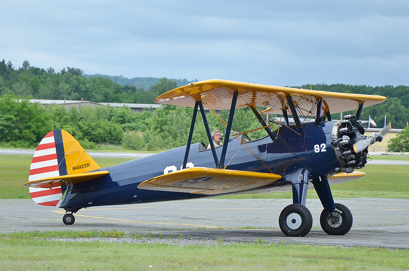 Kit Tucker, owner of Roux Travel in Fitchburg, offered flights in a Stearman plane during the Fitchburg Municipal Airport's 85th Anniversary celebration on Saturday afternoon. SENTINEL & ENTERPRISE / Ashley Green
