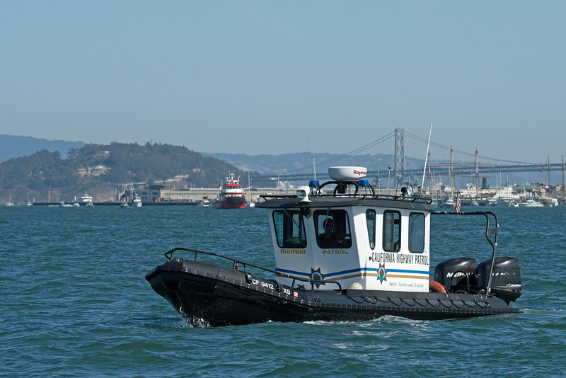 """This small boat had the unenviable job of keeping all the sight-seeing boats in the """"safe zone""""."""