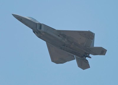USAF F-22 Raptor in a high speed climb.  The F-22 is from Langley, VA