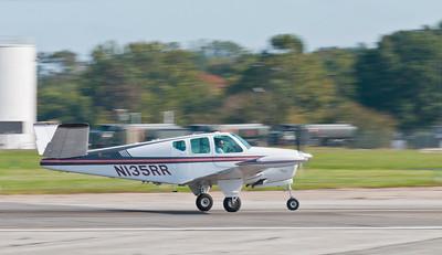 Beechcraft Bonanza  V - tail taking off on Runway 15 - 33