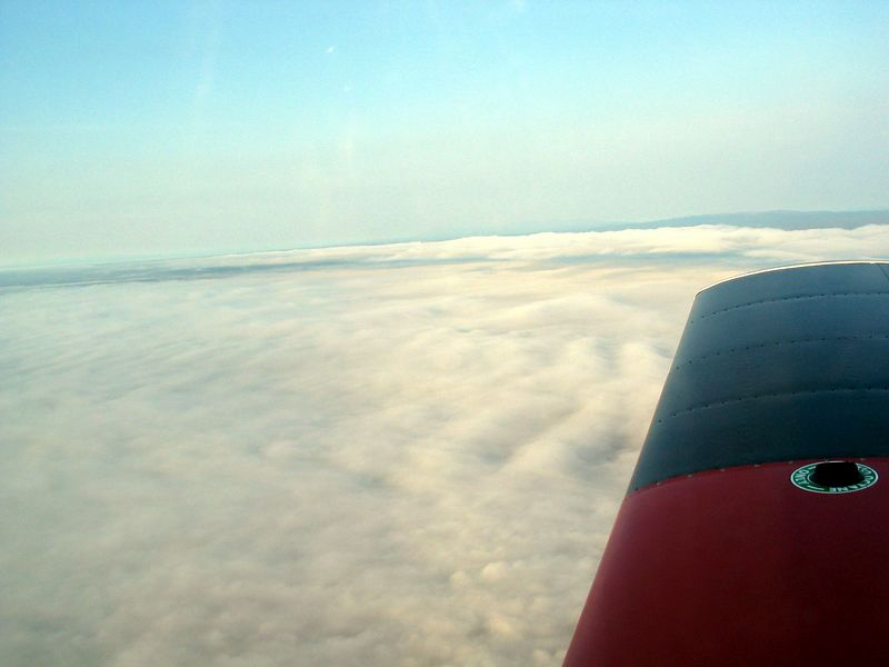 Talkeetna Airport below us, obscured by low clouds, unable to land.