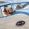 Mayor Stephen DiNatale peeks out of the co-pilot's seat of the Ford Tri-Motor as it prepares for flight on Thursday afternoon at the Fitchburg Municipal Airport. The plane, which had its first flight in 1929, is available for flights Friday through Monday from 9 AM to 5 PM. SENTINEL & ENTERPRISE / Ashley Green