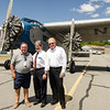 Jack Naylor Sr., Chairman of the Fitchburg Airport Commission, Mayor Stephen DiNatale and Peter Kettle, Vice-Chairman of the Fitchburg Airport Commission, pose in front of the the Ford Tri-Motor as it prepares for flight on Thursday afternoon at the Fitchburg Municipal Airport. The plane, which had its first flight in 1929, is available for flights Friday through Monday from 9 AM to 5 PM. SENTINEL & ENTERPRISE / Ashley Green