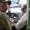 Pilot Dave Ross and Mayor Stephen DiNatale fly the Ford Tri-Motor over Fitchburg on Thursday afternoon. The plane, which had its first flight in 1929, is available for flights Friday through Monday from 9 AM to 5 PM. SENTINEL & ENTERPRISE / Ashley Green