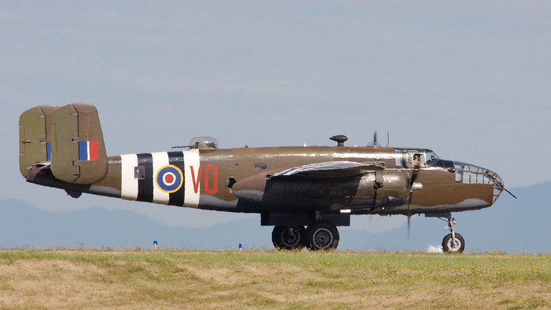 "North American B-25D Mitchell ""Grumpy"" waiting to cross main runway -  a bit of heat ripple."