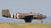 "North American B-25D Mitchell ""Grumpy"" waiting to cross main runway -  a bit of heat ripple."