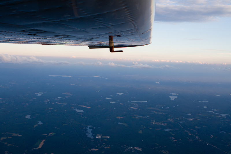 Climbing out above the few clouds around 7000 feet.