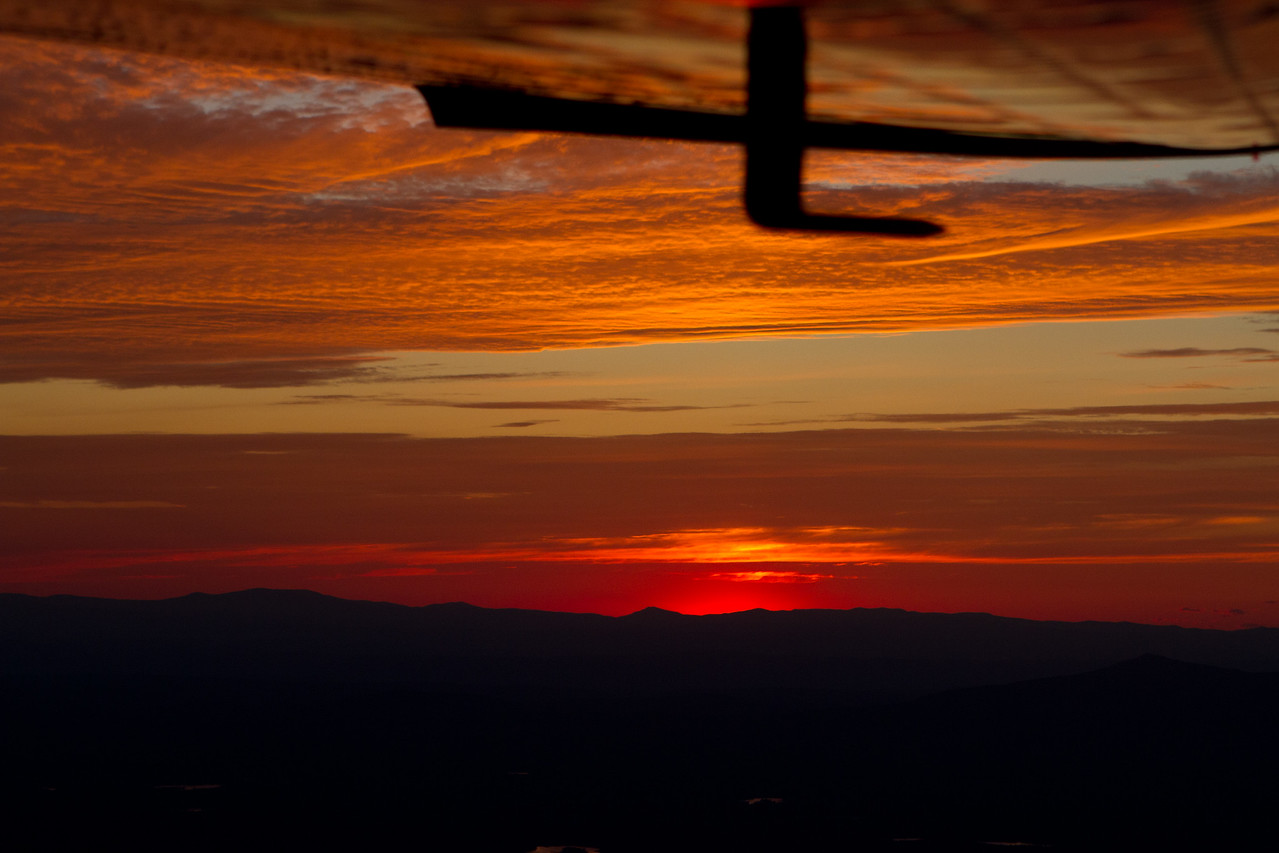 Sunset.. dipping down below the Adirondacks (the closer peak on the right is Mt. Monadnock).