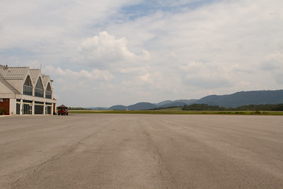 On the ground at Cumberland airport.  There is a fancy terminal building but no airline service right now.  Hills rise all around. - Copyright (c) 2012 Daniel Noe