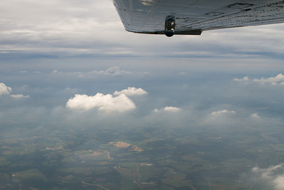Scuddy haze extends beneath the few clouds with darker clouds towards NJ and the coast. - Copyright (c) 2012 Daniel Noe