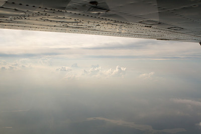 Clouds and haze from 9,500. - Copyright (c) 2012 Daniel Noe