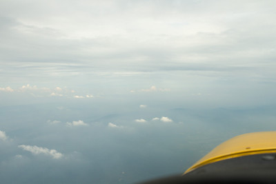 The haze was very extreme over PA here.  Hills poke up out of the haze layer well beneath me (I am at 7,5000 feet).  It is clear, cool, and visibility is good and legal VFR at my altitude. - Copyright (c) 2012 Daniel Noe