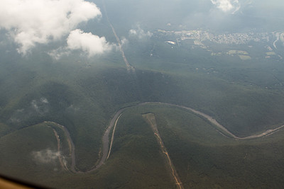 Powerlines crossing between two ridges with river and highway beneath. - Copyright (c) 2012 Daniel Noe