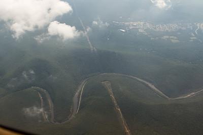 Powerlines crossing between two ridges with river and highway beneath. - Copyright (c) 2012 Daniel Noe