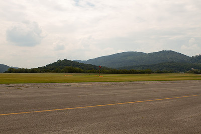 The approach for runway 5 passes over these hills. - Copyright (c) 2012 Daniel Noe