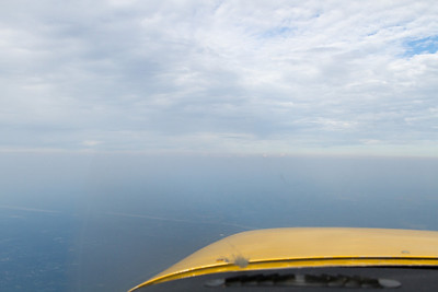 Almost no more lower clouds as I came up on the Hudson River Valley, but the haze is ever present.  Horizon position is deceptive.  This picture really shows how I am above the haze layer.  Forward visibility was excellent. - Copyright (c) 2012 Daniel Noe