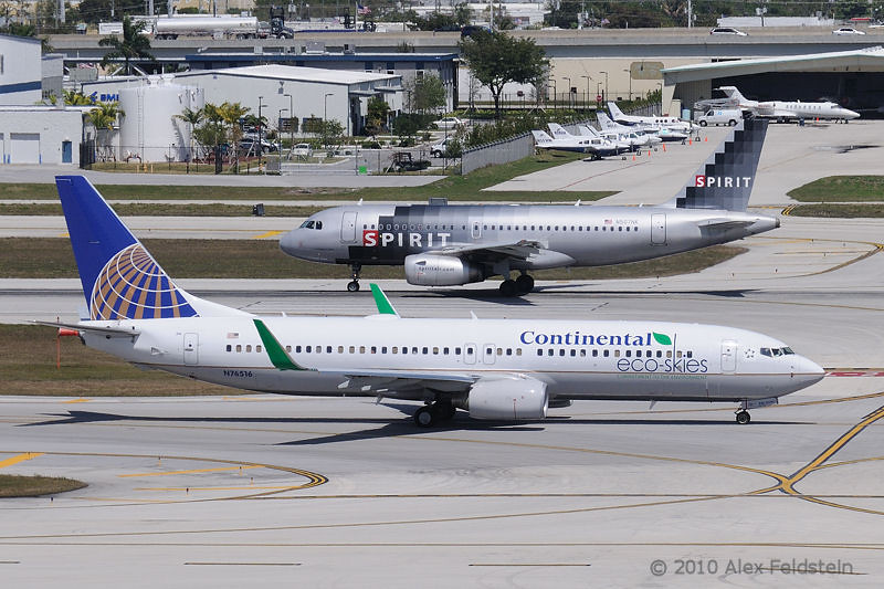 """Continental Airlines """"Eco-Skies"""" Boeing 737-824 and a Spirit Airbus"""
