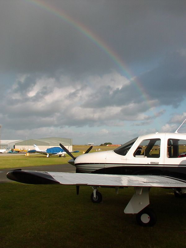 The end of the Rainbow - G-HSPB Commander 115 at Guernsey