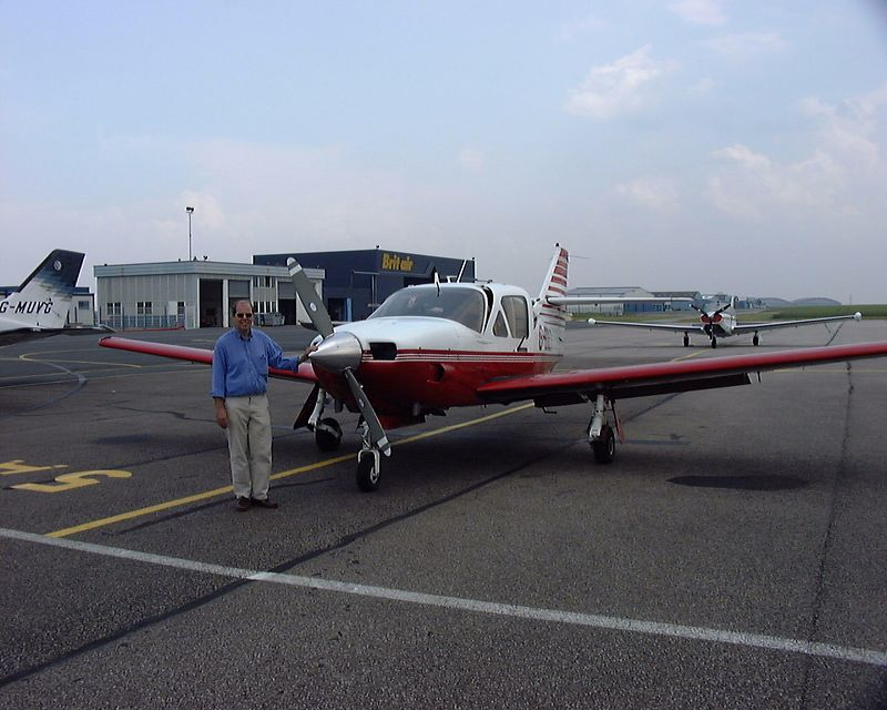 Ian with G-BOLT at Caen (France) having diverted en-route to Guernsey