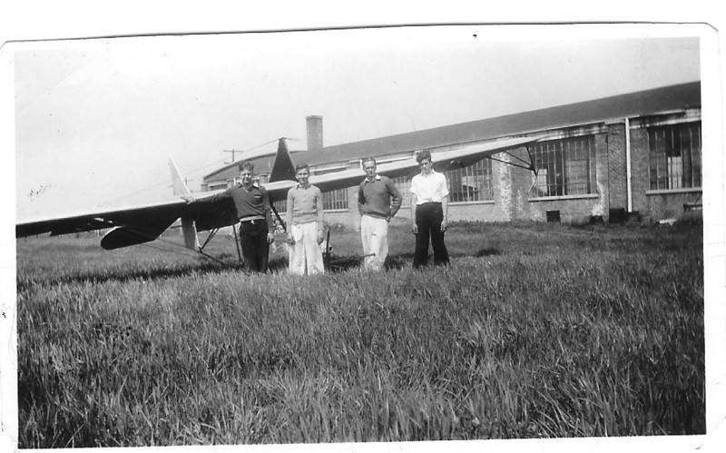 Harry Krueger, Dave Miller, Bill Prescott (third from the left facing the photo) and Jim Rush in front of Northrop Primary Glider.  Photo taken in 1932 at Air Activites Airport - Chicago, IL.