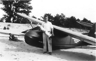 1936 - Bud Fischer holding his first place trophy and his faithful old Franklin Secondary Sailplane.