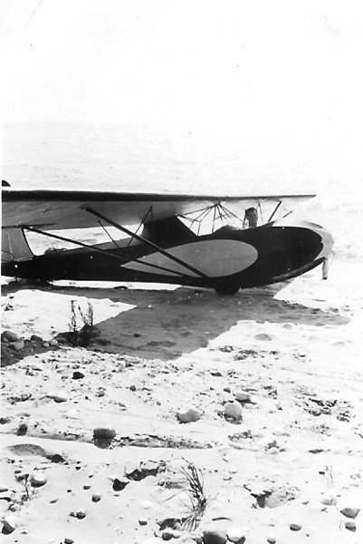 "1936 - Two place Universal at ""The Bear"".  Jack Laister of Laister-Kauffman Sailplanes in the cockpit.  He went into the drink on this flight and became a member of the ""Dunkers Club""."