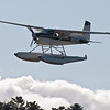 Cessna 185 landing in Greenville during the fly in.