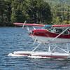 Cessna 180 taxiing on Moosehead Lake.