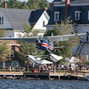 Cessna 180 landing over the town of Greenville on Mooshead Lake.