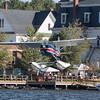Cessna 180 landing over the town of Greenville on Mooshead Lake.