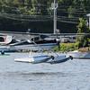 Cessna 170 on amphib floats. Plane has a reversible prop.