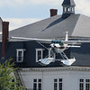 Cessna 185 landing over the Indian Store in downtown Greenville.