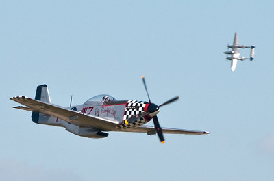 "P-51 Mustang ""Big Beautiful Doll"" with P-38 Lightning in the background"