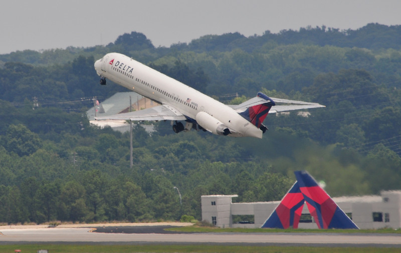 I like how I managed to get the two tails as this MD-80 takes off.