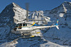 HB-ZFF AS350B3 Helog @ Lauberhorn Switzerland 15Jan05 - In the background Eiger 3970m and Mönch 4107m